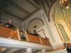 Фотограф поймал момент. Вальтер Мицкевич на балконе, а Пётр Мицкевич на кафедре. Съезд проходит, а они хохочут.