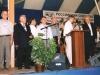 Ветераны на сцене Конгресса. Василий Ефимович принимает памятную грамоту от братства.